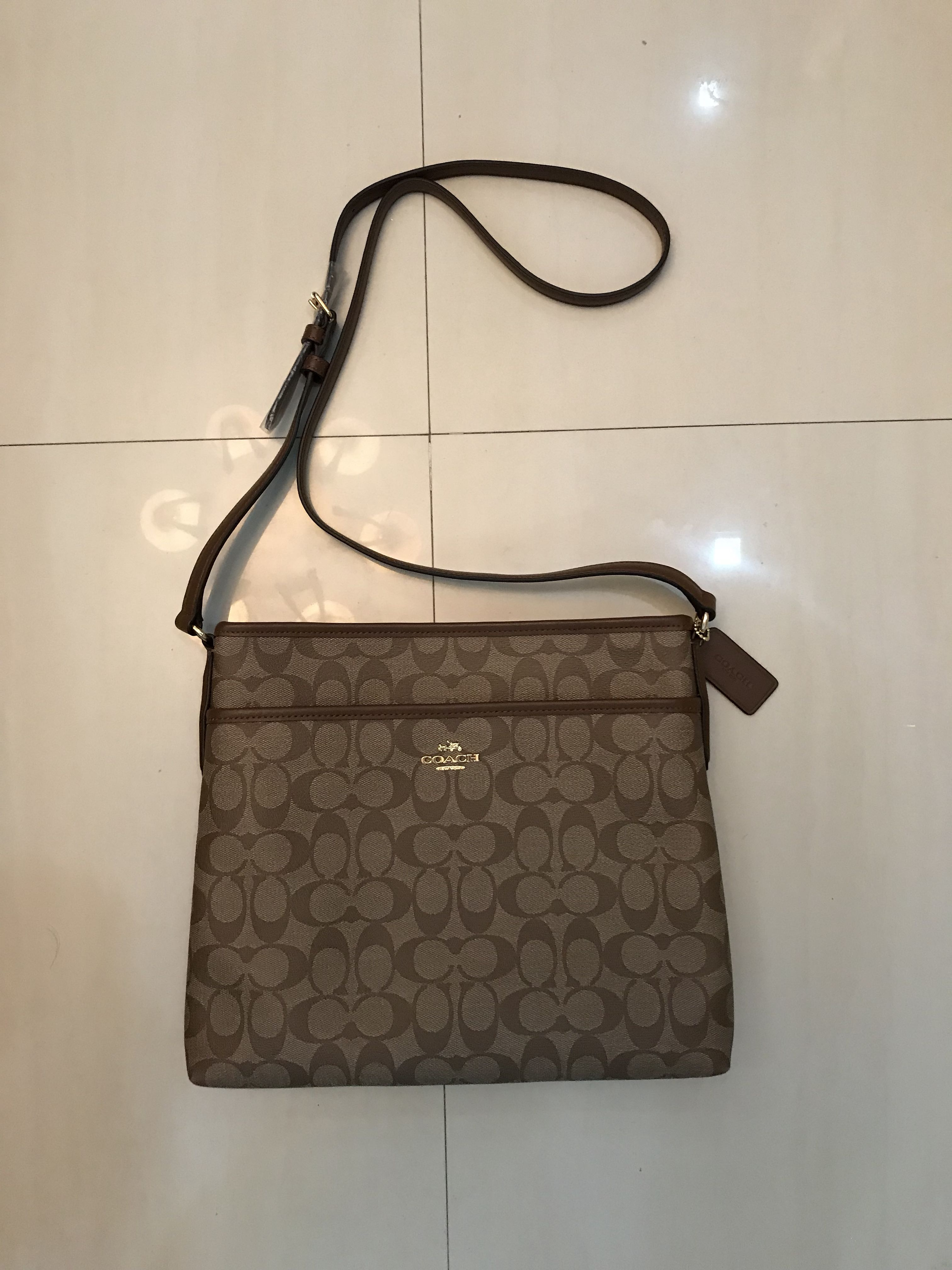 Brand New Auth Coach Women s F58297 Signature File Sling Bag  (Brown Saddle) d2bd2bb98d