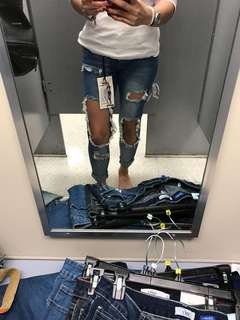 Ripped distress jeans with big holes