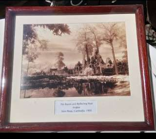 A pair of framed Cambodia's famous Siem Reap Angkor Wat heritage monochromed pictures.