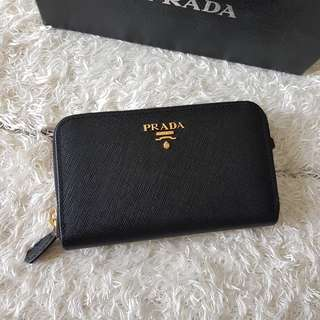 Authentic Prada Saffiano Midsize Zippy Wallet in Nero