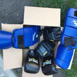 Punching bags with gloves and knee pads packaged