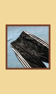 black three-striped track pants