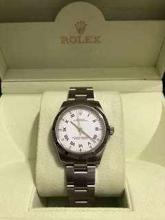 Authentic Rolex Oyster Perpetual. Boy size (32mm) comes with box only.