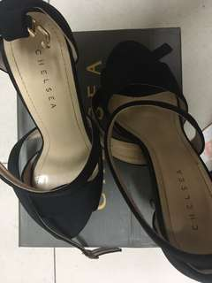 Chelsea Black Heels Size 7 Four inches high Used Once