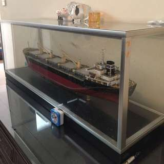 Antique replica of cargo ship vessel within intact glass casing