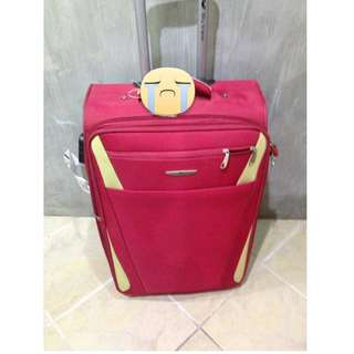 Red luggage (medium size)