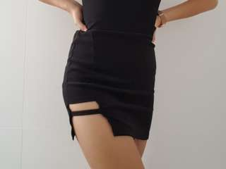 black cutout mini skirt