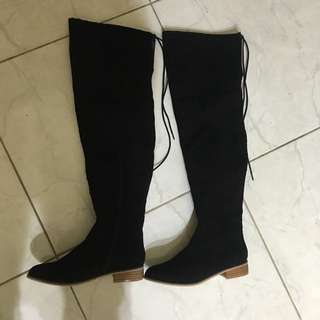 Thigh high black suede boots