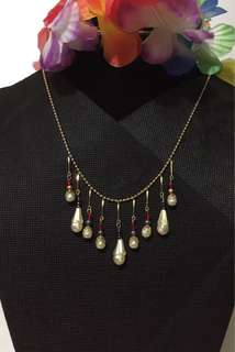 Gold tone necklace with beads