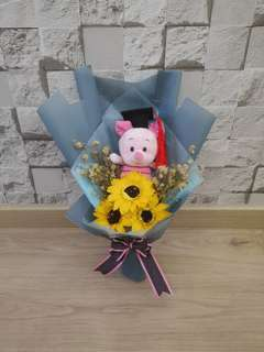 Piglet sunflower graduation bouquet with baby breath
