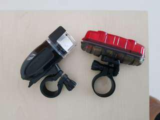 Front and rear brompton bicycle lights. Uses AA battery. Included.