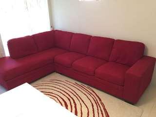 Red L shape designer sofa