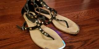 Stylish black and gold sandals