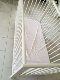 Baby cot with water proof mother care mattress