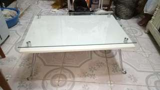 With glass center table