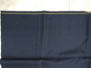 Dark blue fabric w yellow line at edge