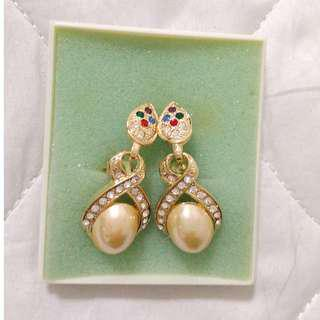 Brand new Pearl Earrings with faux diamonds.  Clip-on type.