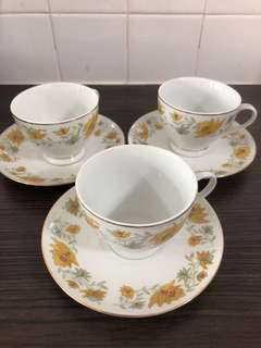 Set of tea cups with saucers