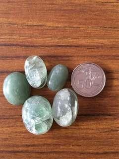 Green cabochon stones