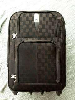 Small medium brown luggage