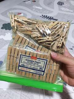 Wooden pinch pegs
