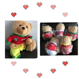 Teddy bear in country soccer jerseys
