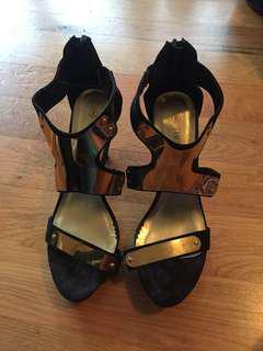 Gold feature high heels