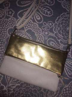 gold and cream bag