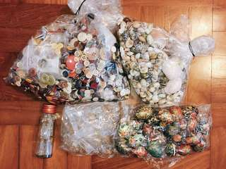Buttons, shells, glass bottles, painted eggs