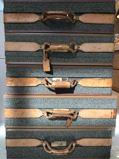 Vintage Leather wrapped suitcases.