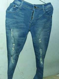 Celana jeans wanita ripped