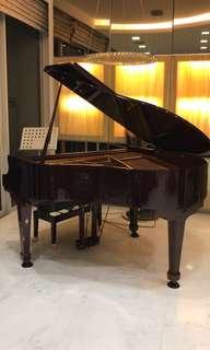 Baby grand piano samick