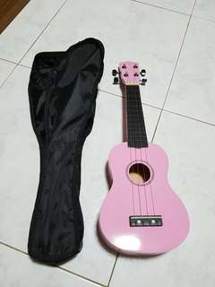Ukulele Pink colour c/w carrier for beginners