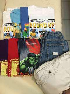 Bundle of t-shirts and pants and jeans