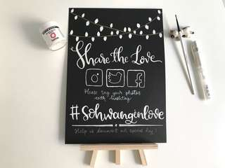 Chalkboard effect wedding hashtag display card