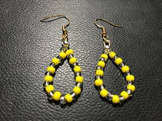 Oval-beaded earrings (yellow & silver beads)