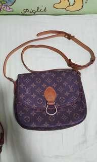 LV leather sling bag