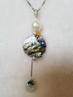 Mother of pearl and jade pendant