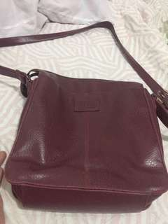 Relic by fossil sling bag