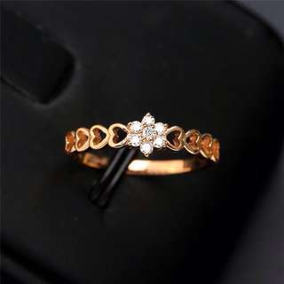18KT Solid gold diamond heart and flower design . 7 Diamonds . Available in white gold
