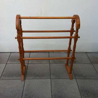 Wooden stand. Can be used for hanging towers in the bathroom or newspaper in the living room