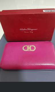 ferragamo pink long wallet. good condition. no stains tear and scuffings. logo bit faded.