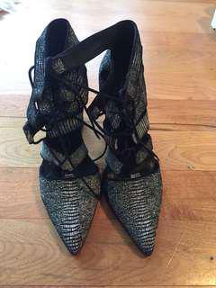 Strappy designer heels