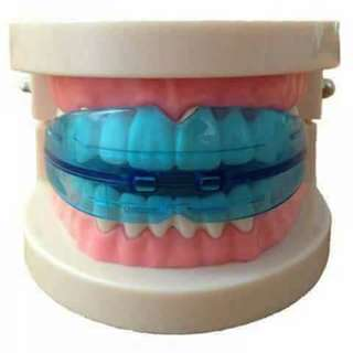TEETH RETAINER