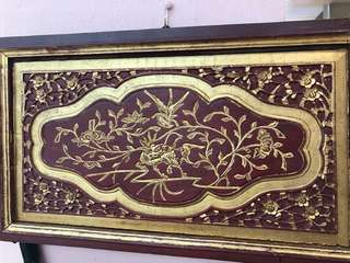Old wooden carved panel with gold gild in frame