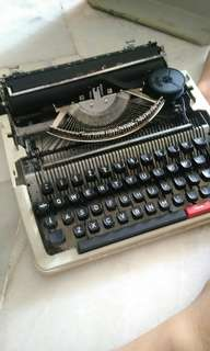 Type writer in a case