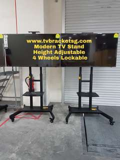 TV Mounted on TV Mobile Stand for Display Up To 80""