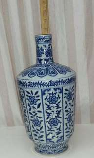 A  hand painted flower vase,  museum replica