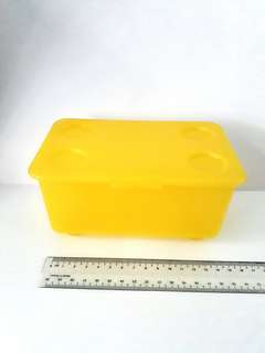 Frosted transparent yellow box container with lid cover
