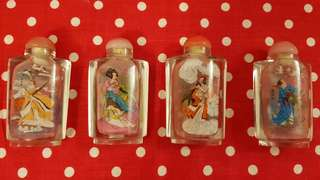 Eight Immorpals hand painted glass bottles